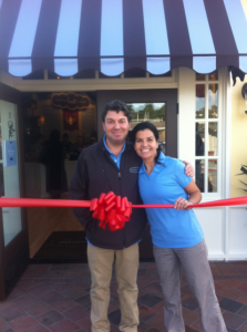 Image of a couple cutting a ribbon on new storefront