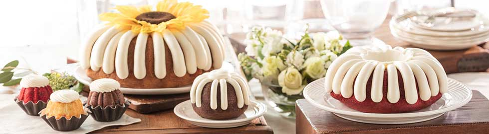 Various sizes of Bundt Cakes arranged on a table